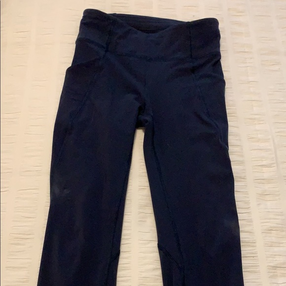 Lululemon size 4 navy leggings with side pockets